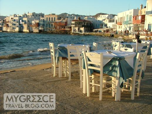 Tables next to the seaside at a taverna in Little Venice in Mykonos Town