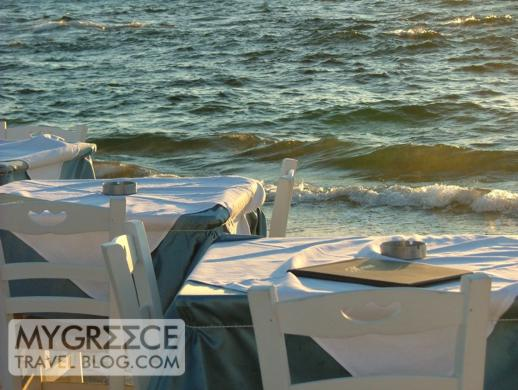 Tables next to the sea at a Little Venice taverna