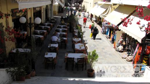 tavernas and shops on a street in Kos Town