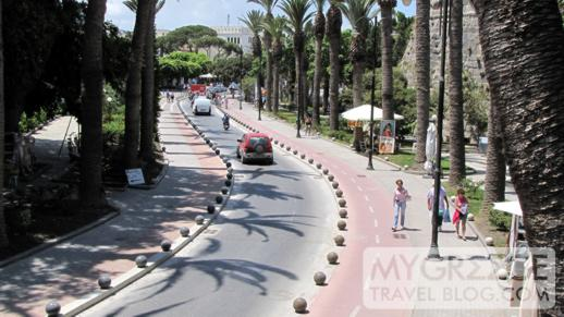 the palm tree lined street outside the castle in Kos Town
