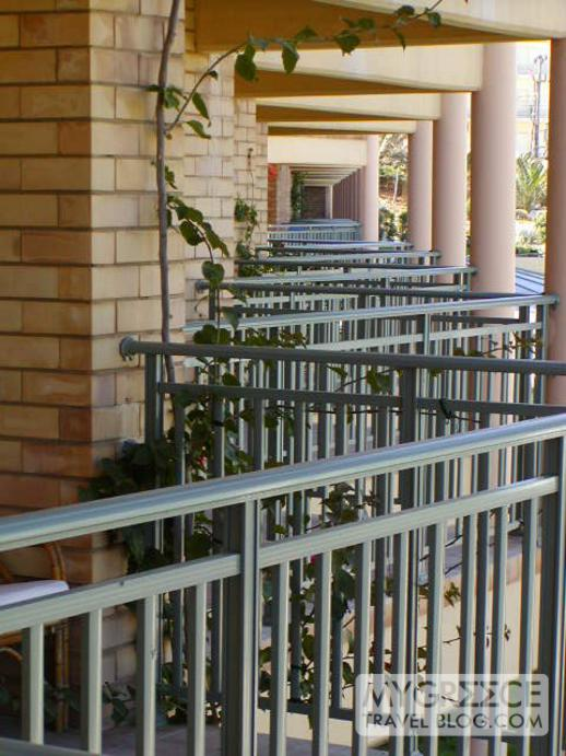 a row of balconies at the Candia Maris Resort & Spa Crete