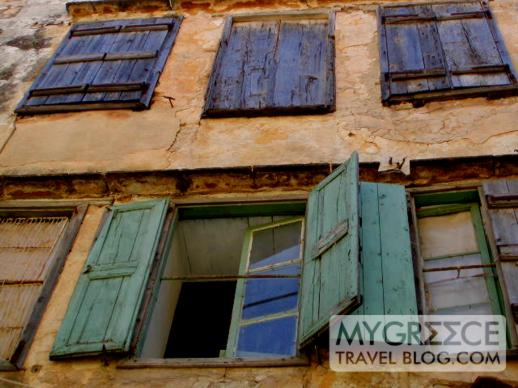 window shutters on a building in Chania