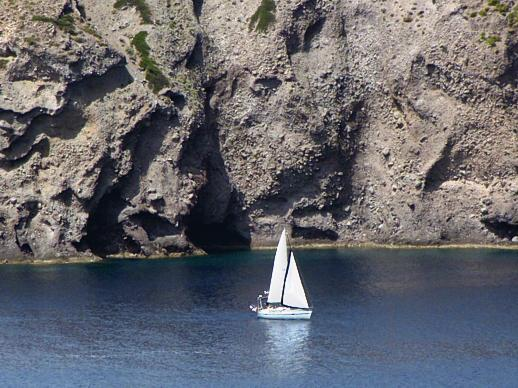 sailboat off the coast of Milos