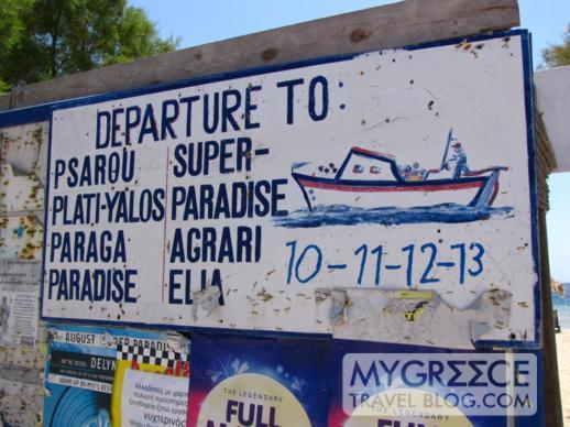 Ornos beach shuttle boat sign