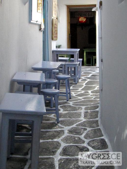 cafe tables on a narrow Mykonos street