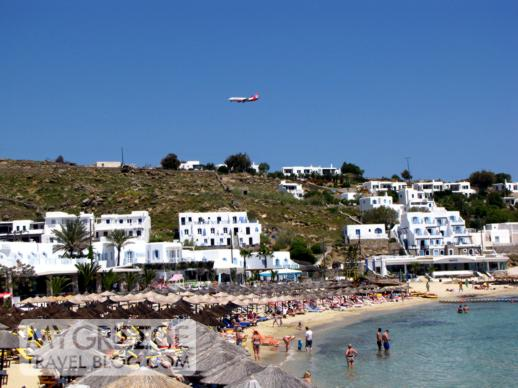 Air Berlin jet above Platis Gialos beach Mykonos