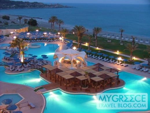 Rodos Palladium hotel swimming pool at dusk