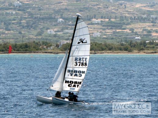 a catamaran sails in Agios Georgios Bay at Naxos