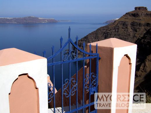 a blue gate on Santorini
