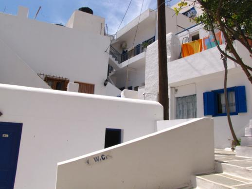 a house on the mountainside in Chora