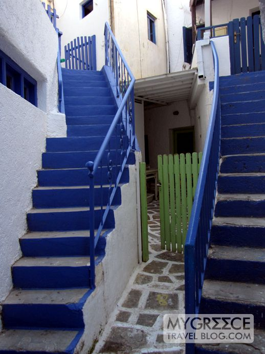 blue staircases and a green gate