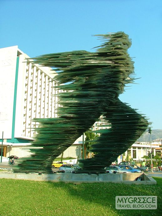 Dromeas the glass running man statue in Athens