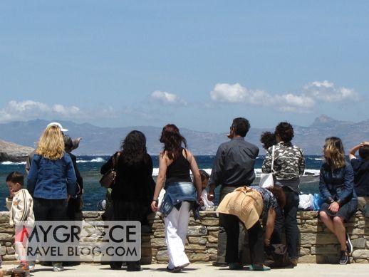 tourists on Delos looking toward Mykonos