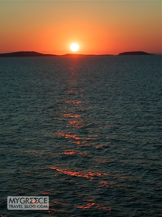 Naxos view of a sunset behind Paros island