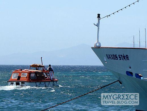 cruise ship tender passes Naxos Star