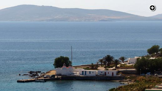 boat pier and churches at the west end of Agios Ioannis