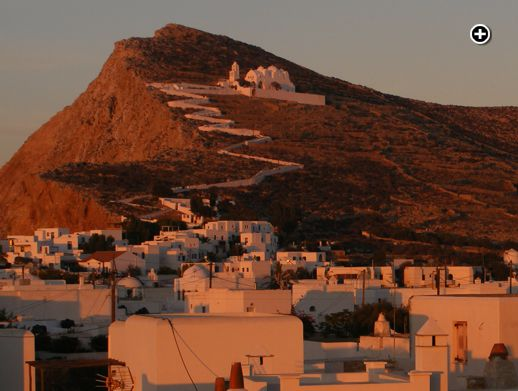 A sunset view of the Church of the Panaghia on the mountainside above Chora on Folegandros