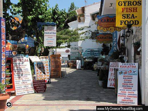 Signs along a row of restaurants in Kokkari