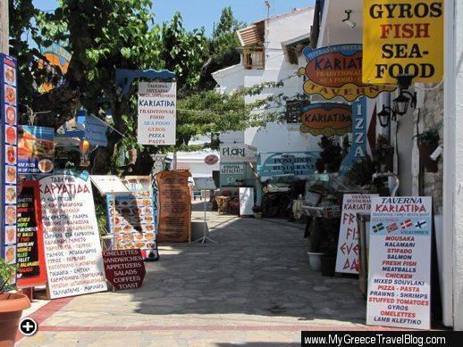 Signs along a row of restaurants in Kokkari