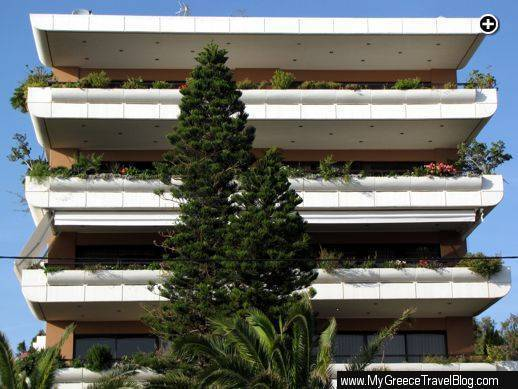 Plant and flower-filled terraces on a midrise residential building in Glyfada