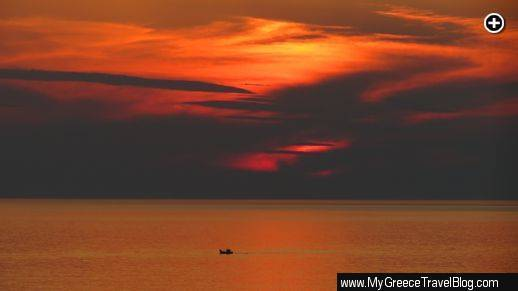 A fishing boat motors past Mykonos during a spectacular sunset on May 15 2013