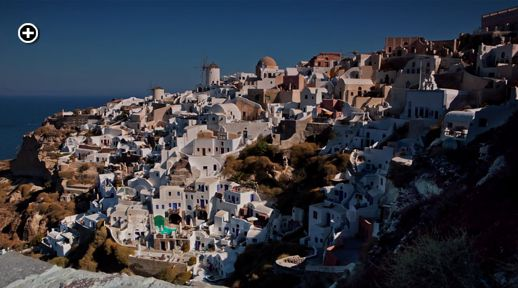 Santorini Freedom film view of early morning sunshine on the village of Oia