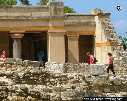 Tourists explore the ruins of Knossos Palace near Heraklion on Crete