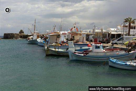 Fishing boats docked near the Venetian fortress at Naoussa harbour
