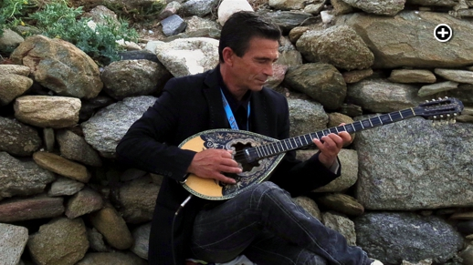 A musician plays the bouzouki in the Kastro area of Mykonos Town