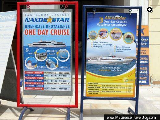Sandwich board signs advertising Delos and other island tours from Naxos
