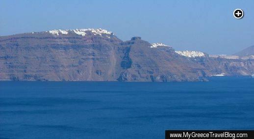 This view from Santorini's Oia village takes in Imerovigli, Skaros Rock and Fira