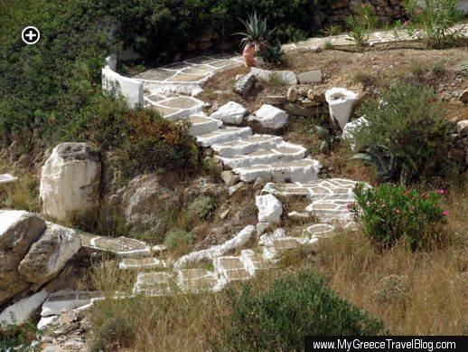 a path of cement steps winds down the hillside above Tzamaria beach on Ios