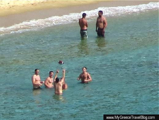 People in the water at Mylopotas beach on Ios