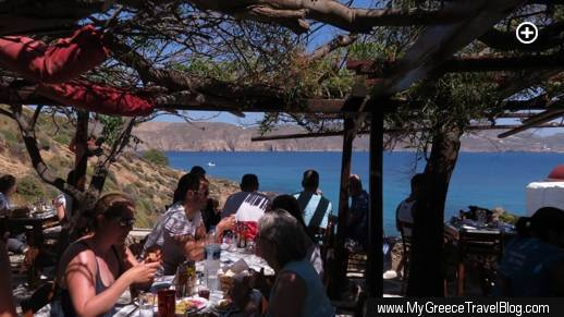 The tree- and vine-sheltered dining terrace at Kiki's taverna at Agios Sostis beach on Mykonos