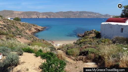 A picturesque cove and sandy beach on Panormos Bay below Kiki's Taverna at Agios Sostis