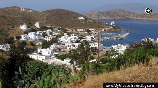 Looking down on the Gialos port and harbour area of Ios island from the footpath to Chora village