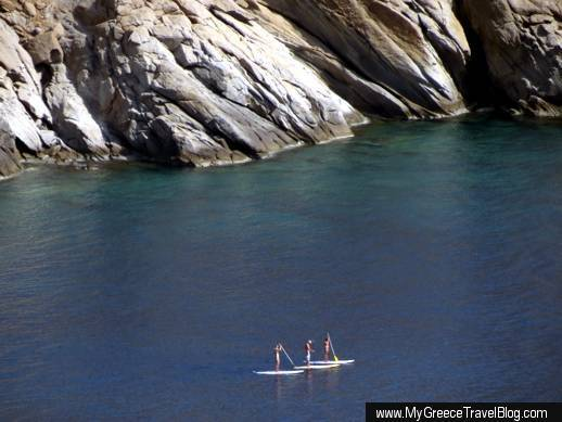 Stand up paddle surfing in Mylopotas Bay on Ios