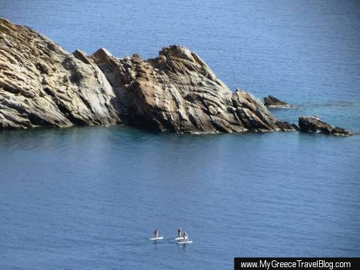 Stand up paddle surfing in Mylopotas Bay on Ios island