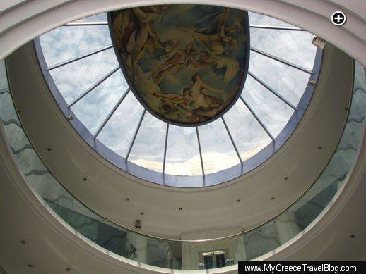 Artwork adorns the ceiling of a shopping enter atrium in Glyfada