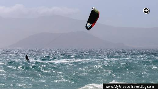 A kitesurfer skims across the choppy sea off Agios Prokopios beach at Naxos on May 23 2013