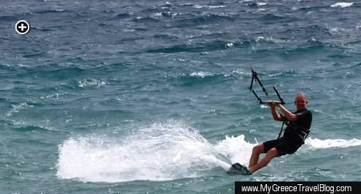 A kitesurfer slaloms on the sea off Agios Prokopios beach on Naxos