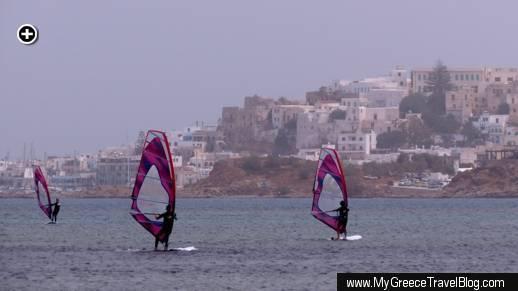Windsurfers sail across Agios Georgios Bay near Naxos Town on Naxos