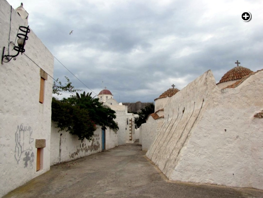Stormclouds pass above churches in Chora village on Patmos