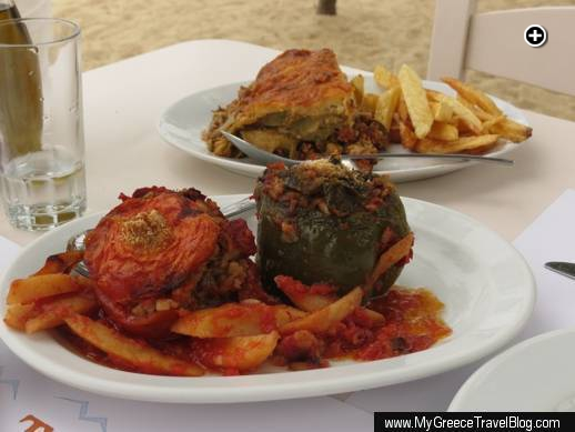 Stuffed tomatoes and peppers (front) and moussaka with fries at Nikolas Taverna on Mykonos