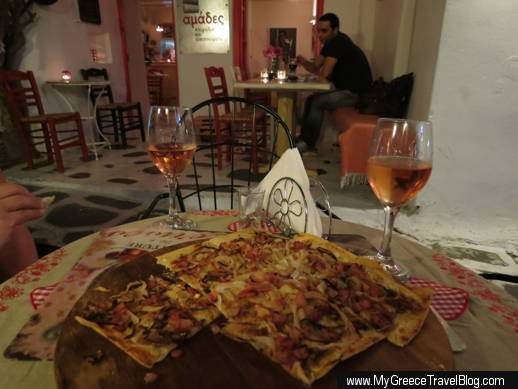 Tarte flambee and glasses of rose wine