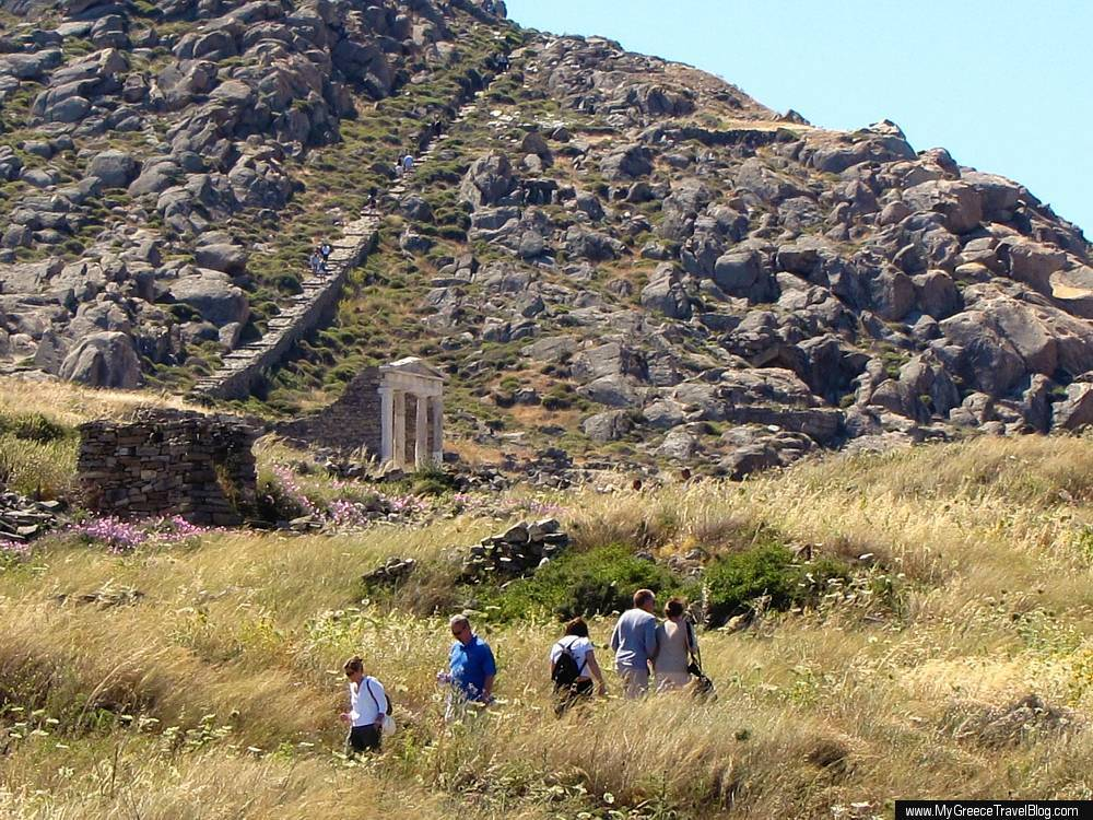 Tourists explore Mt Kynthos and the ruins on Delos island