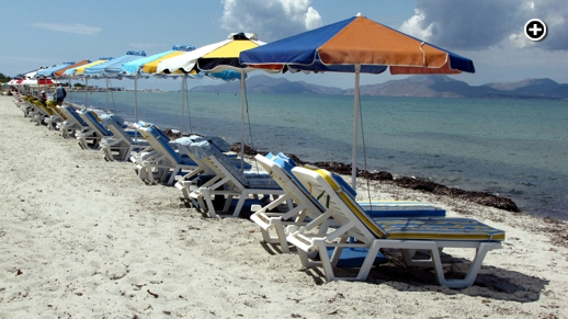 Sunbeds on a beach near the Tigaki resort area of Kos island