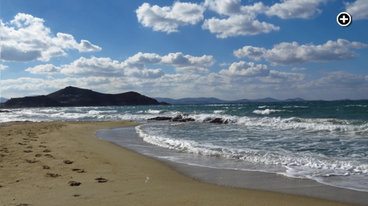 Waves break off St George's Beach on Naxos island during a windy but gloriously sunny October afternoon