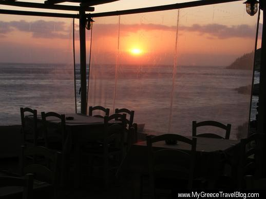 Dining terrace at the Delfini Hotel on Sifnos sunset view
