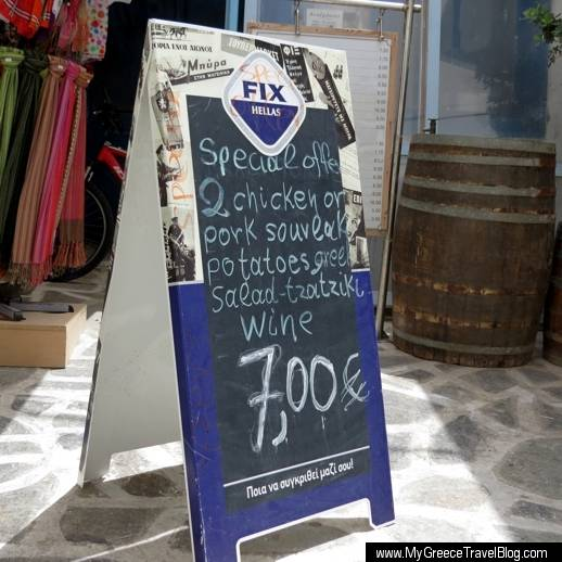 a restaurant menu sign in Naxos Town